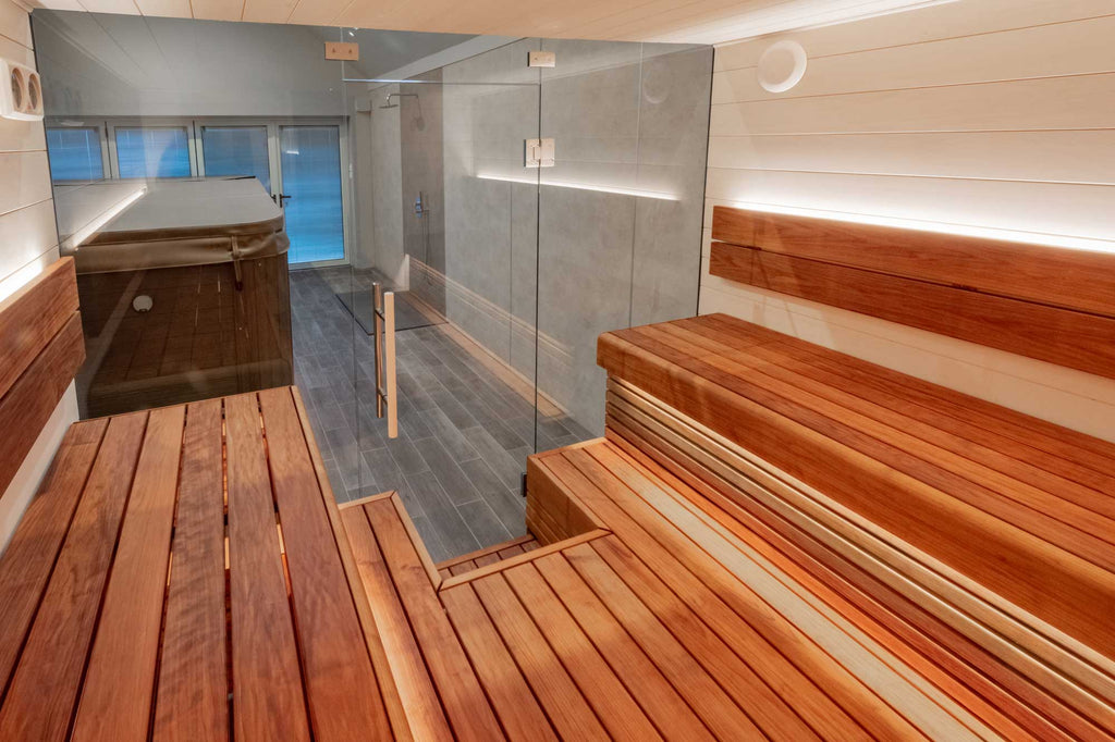 The bench arrangement is one of our favourite layouts for sauna benching, as we (The Sauna Twins) love this communal feel that comes from being able to face other sauna users and have a chat. It is two opposing raised benches with a raised floor in between them.