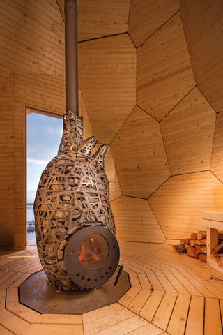 Wood fired sauna stove inside the golden egg sauna
