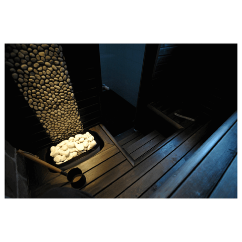 White Sauna Heater Decorative Cover Stones in a Sauna