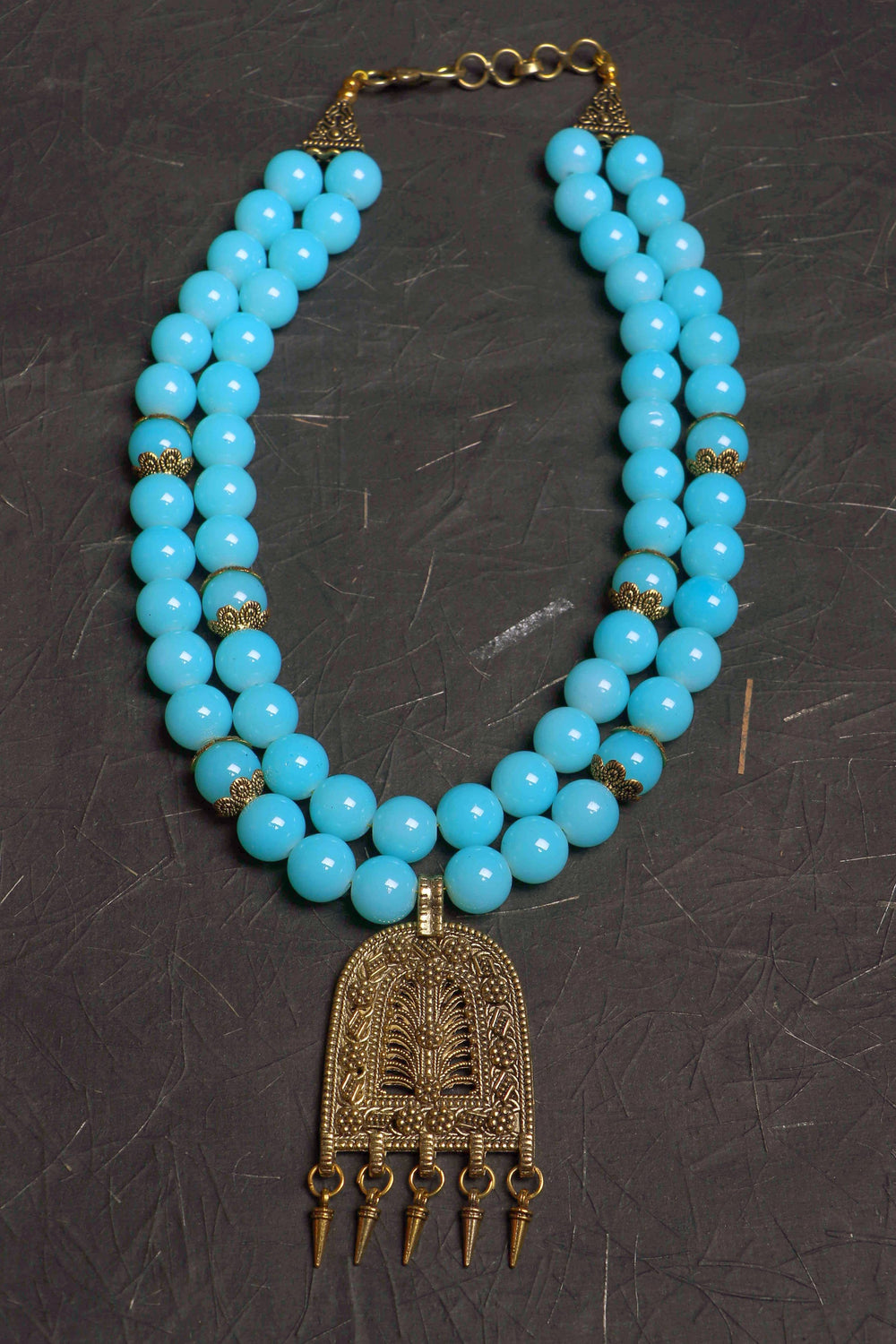 glass bead necklace in large double stranded sky blue glass beads, with antique gold pendant