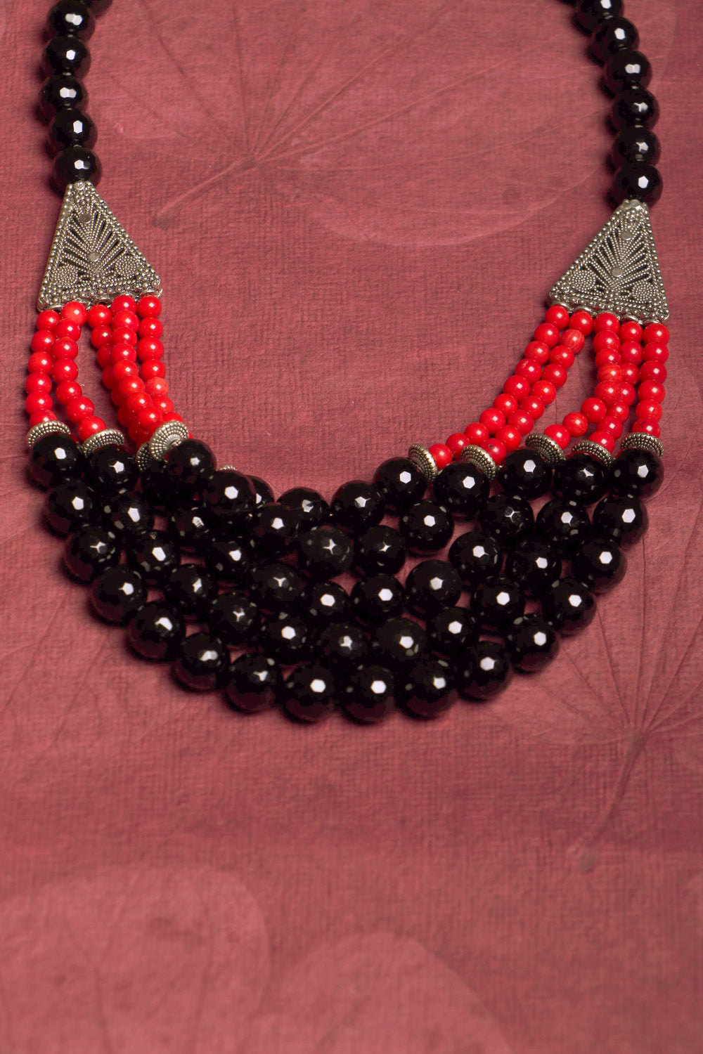 Layered black onyx and red coral neck piece, with German silver accents.