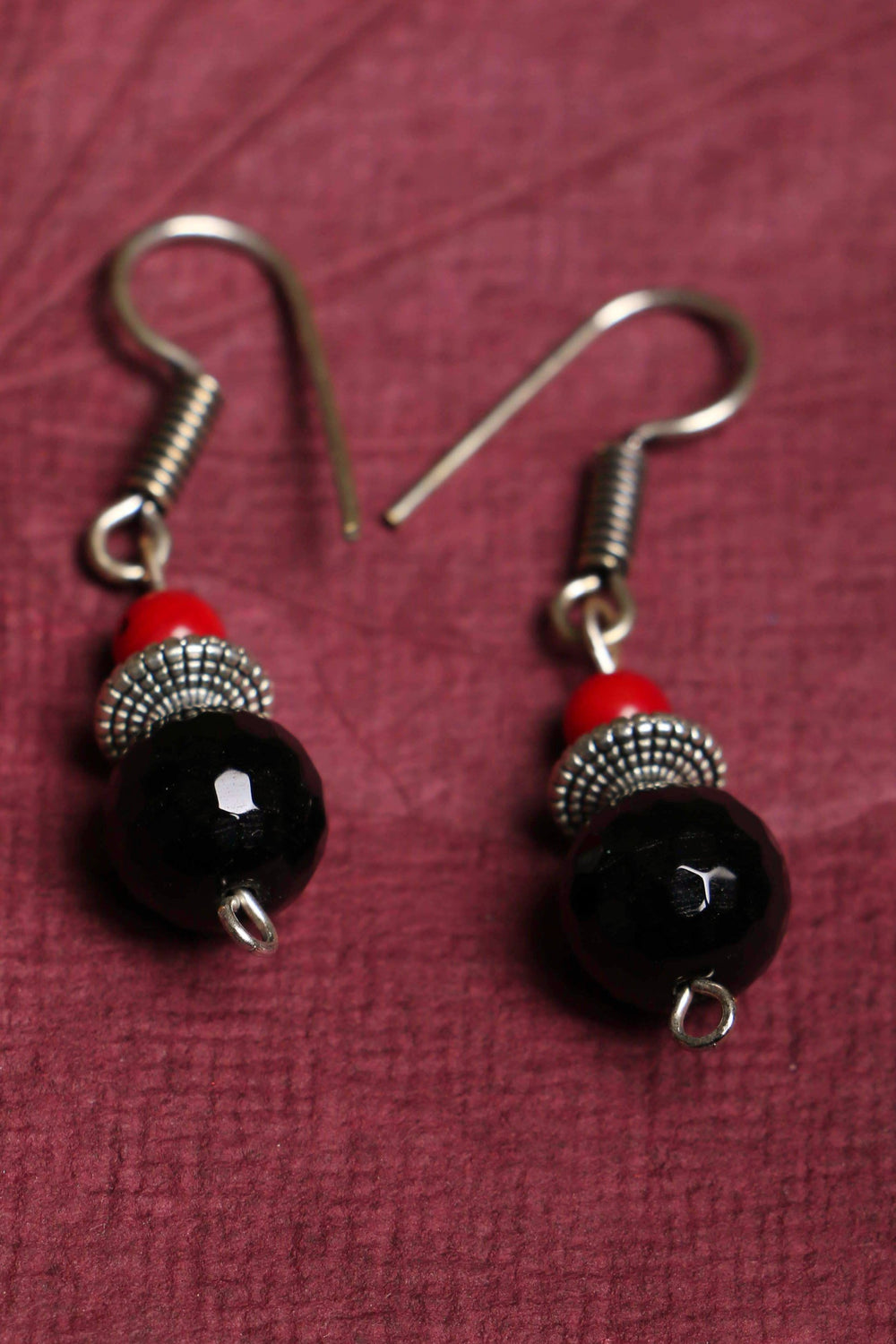 Black onyx and red coral earrings, with German silver accents