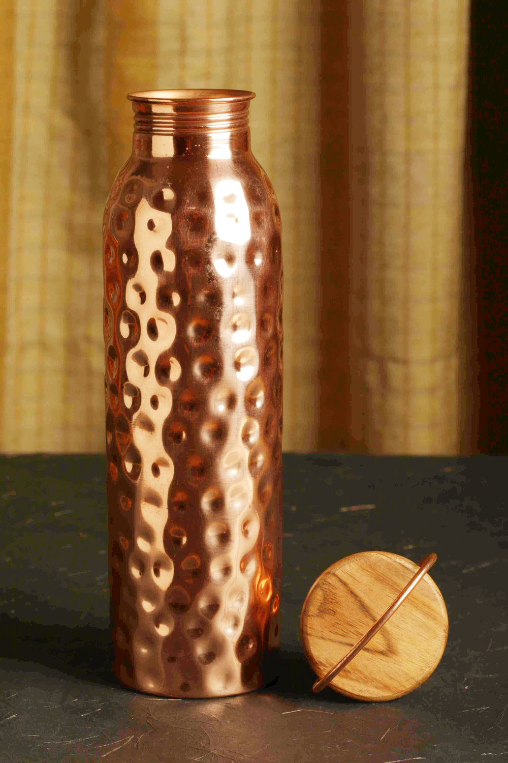 Copper water bottle with wooden cover top