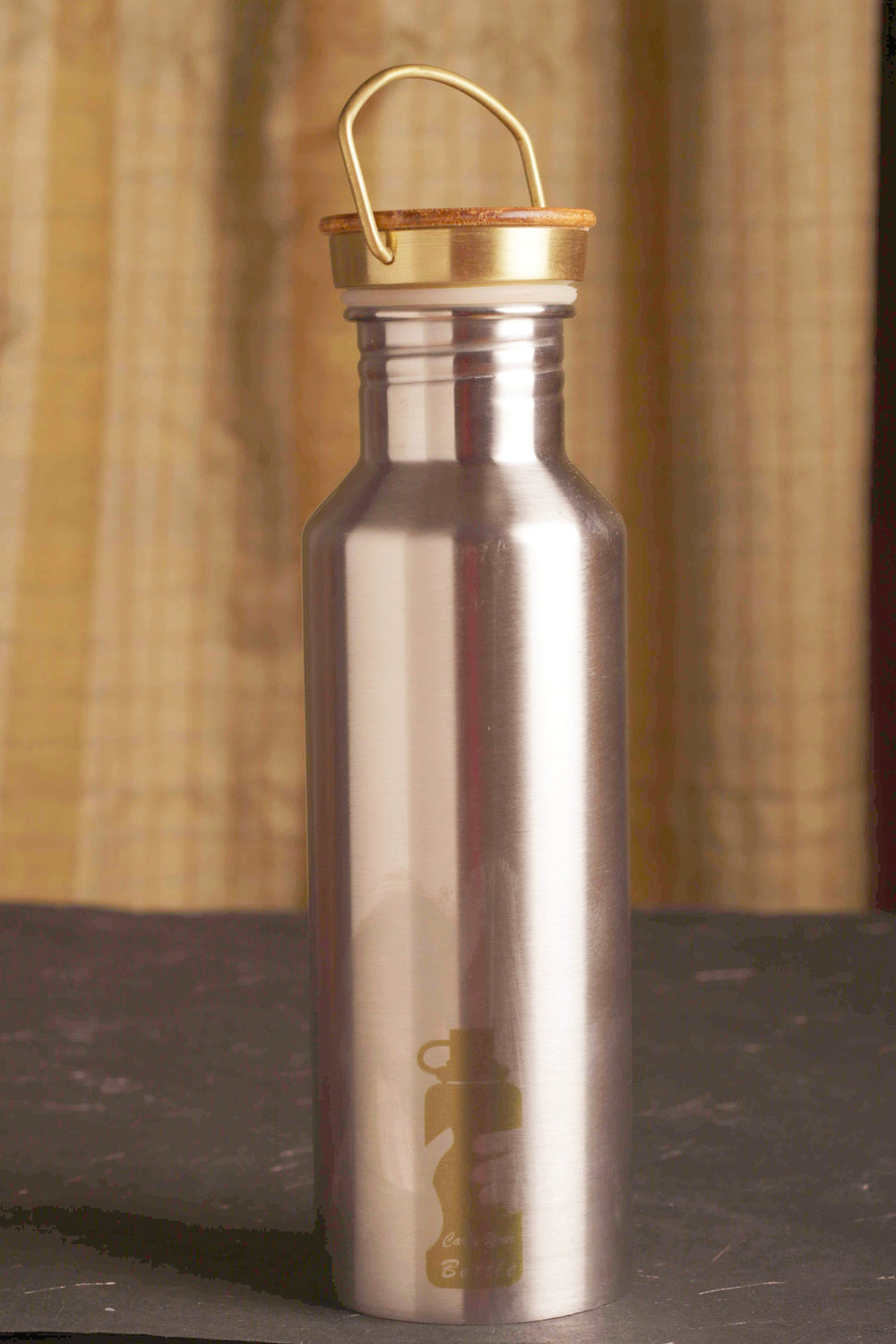 Stainless steel water bottle with wooden cover