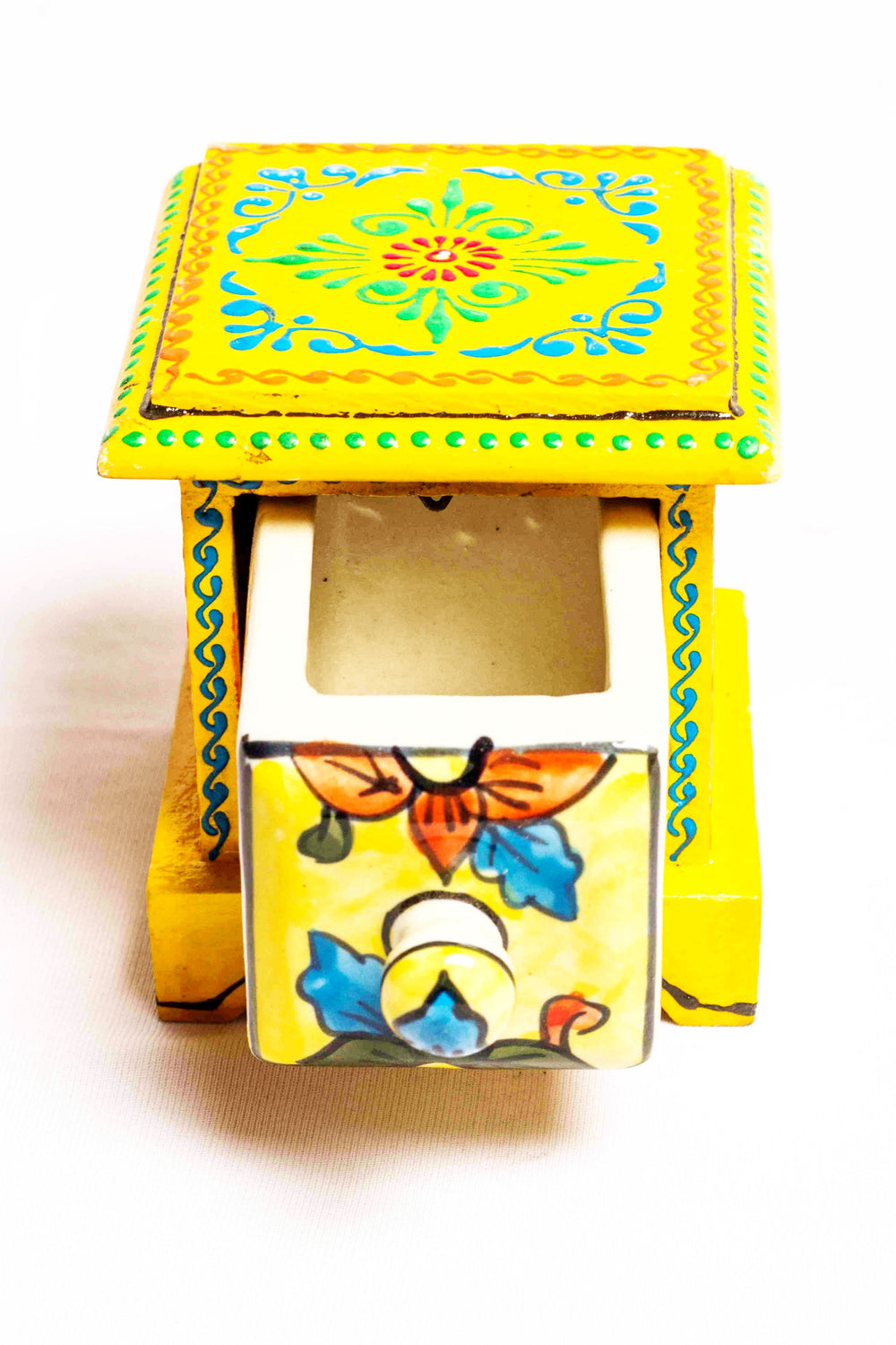 Single drawer in a yellow framed wooden box with painted motifs, with a ceramic drawer