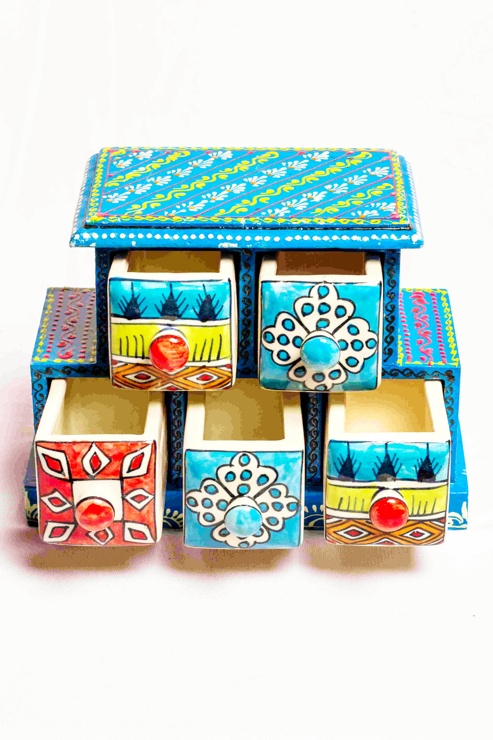 Chest of drawers in a blue framed wooden box with painted motifs, with 5 ceramic drawers