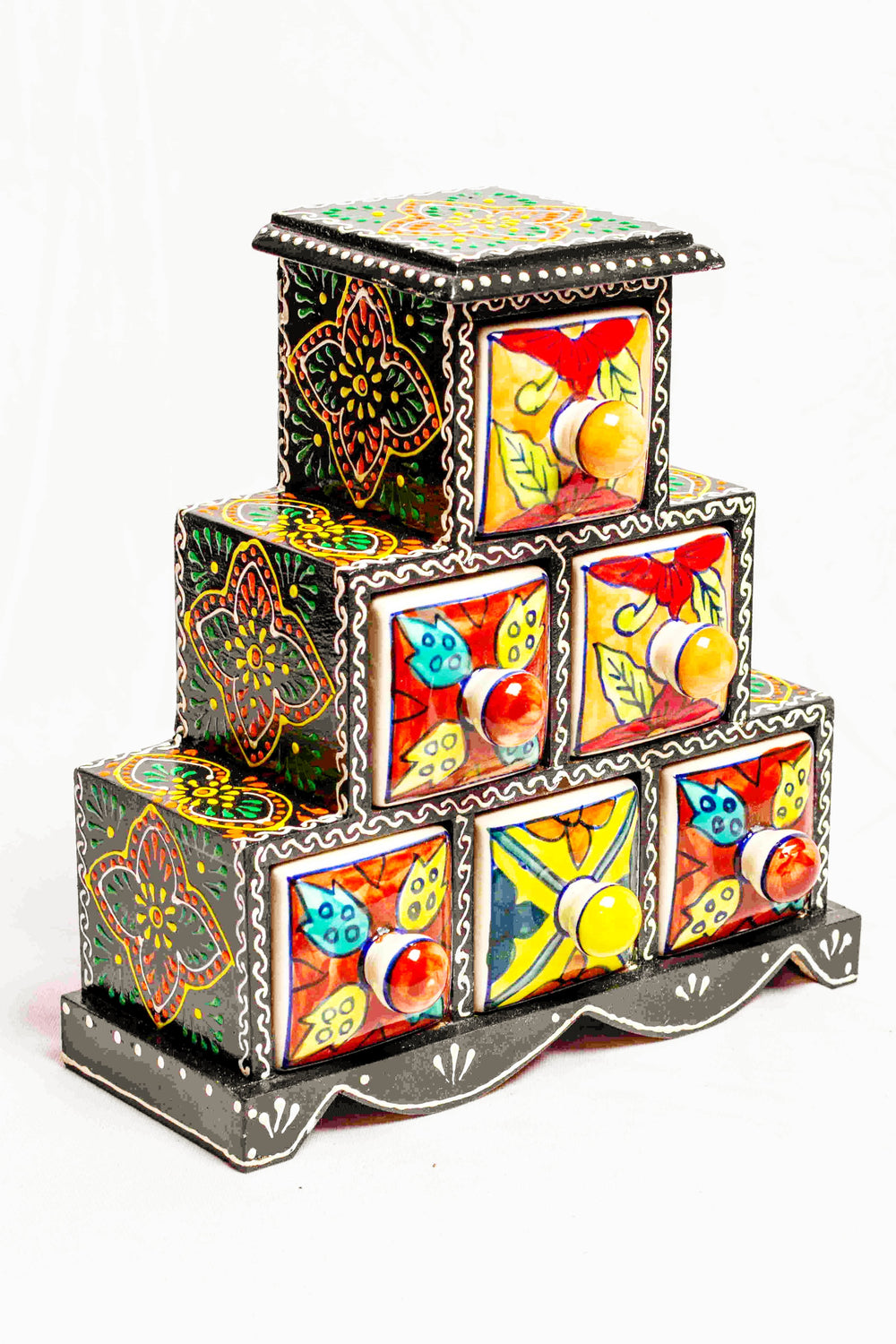 Chest of drawers in a black framed wooden box with painted motifs, with 6 ceramic drawers
