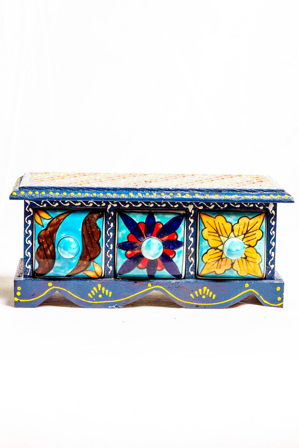 Chest of drawers in a dark blue framed wooden box with painted motifs, with 3 ceramic drawers