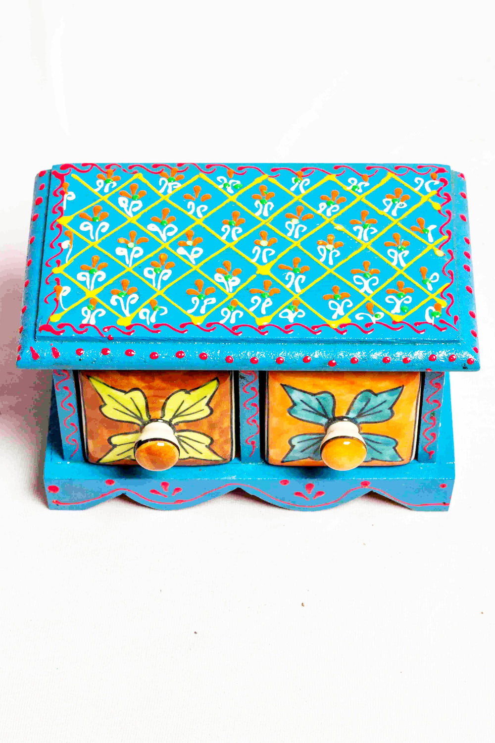 Chest of drawers in a blue framed wooden box with painted motifs, with 2 ceramic drawers