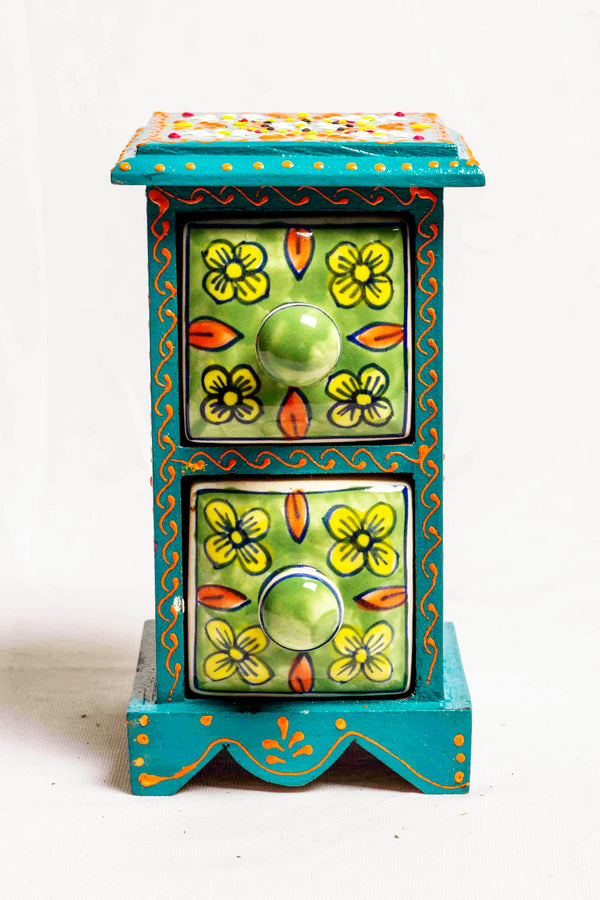 Two drawers in a green framed wooden box with painted motifs, with 2 ceramic drawers