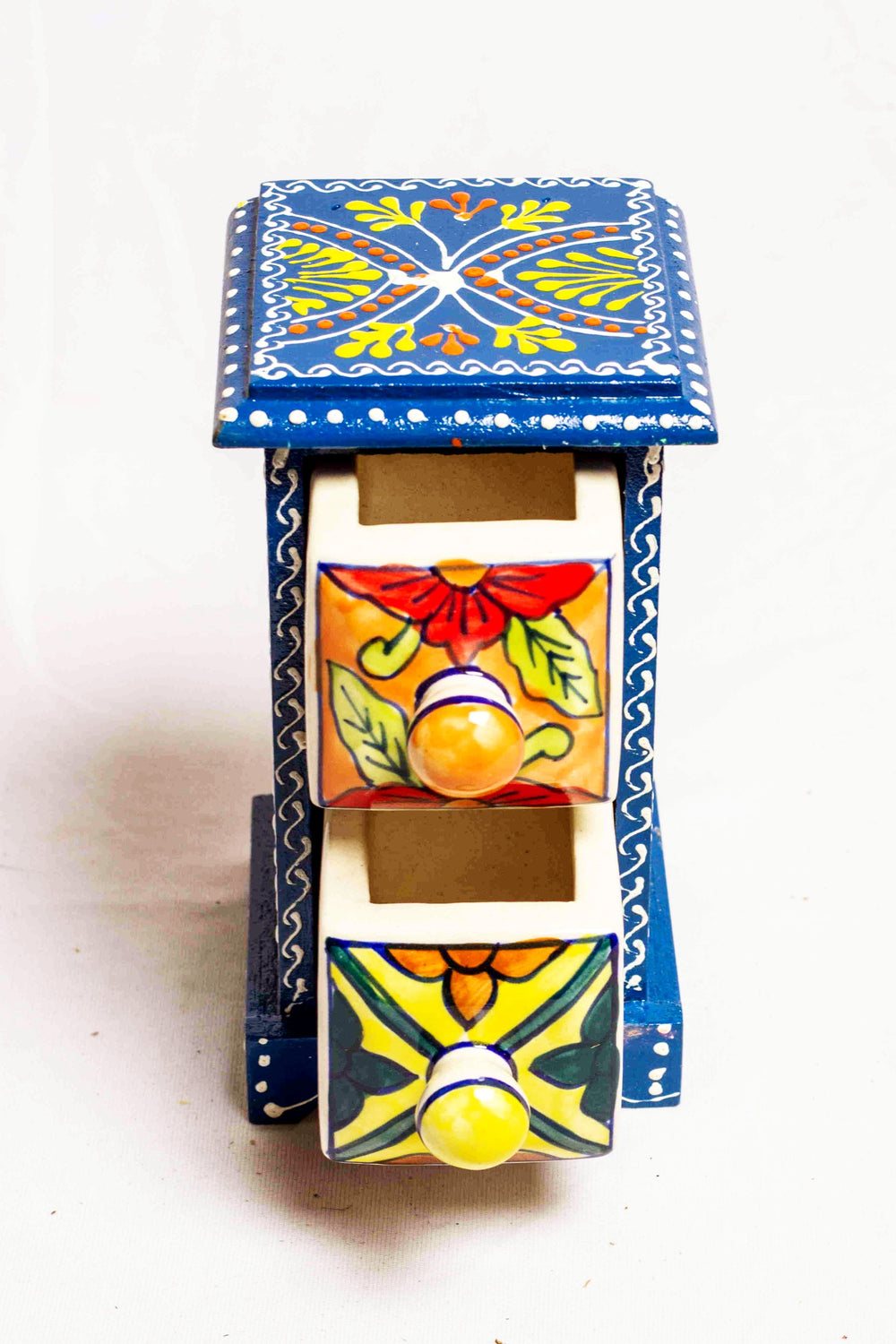 Two drawers in a dark blue framed wooden box with painted motifs, with 2 ceramic drawers
