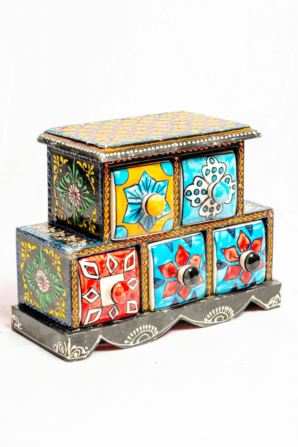Chest of drawers in a black framed wooden box with painted motifs, with 5 ceramic drawers