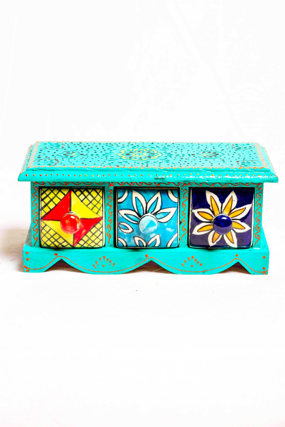 Chest of drawers in a green framed wooden box with painted motifs, with 3 ceramic drawers