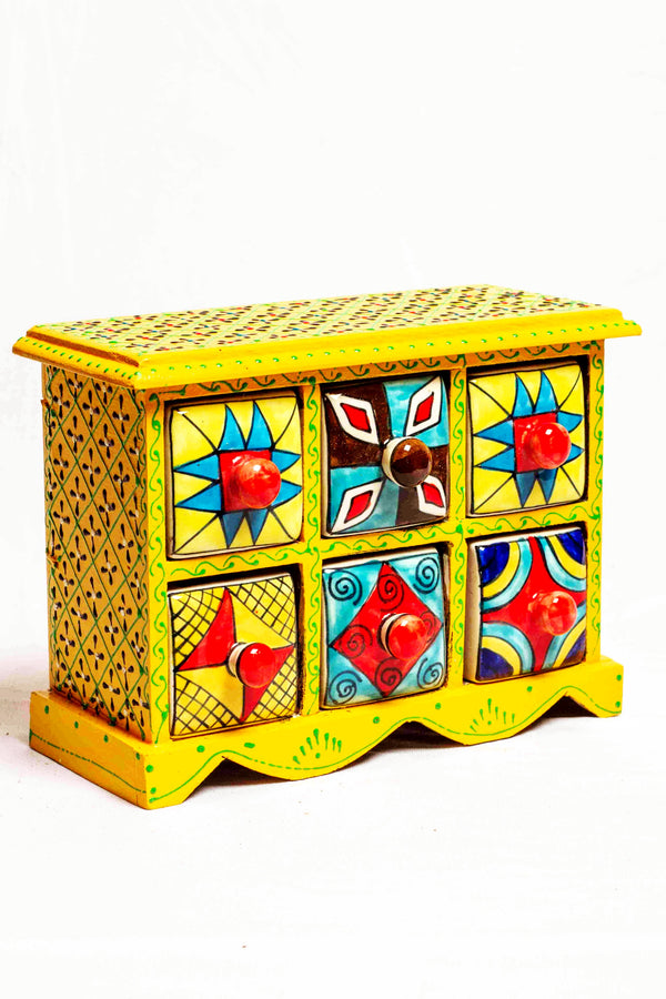 Chest of drawers in a yellow framed wooden box with painted motifs, with 6 ceramic drawers
