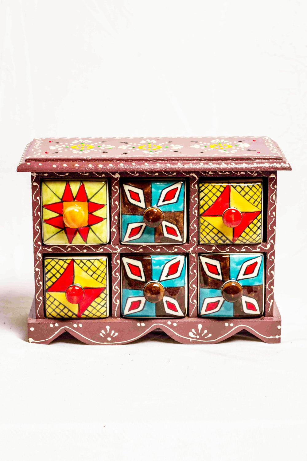 Chest of drawers in a brown framed wooden box with painted motifs, with 6 ceramic drawers