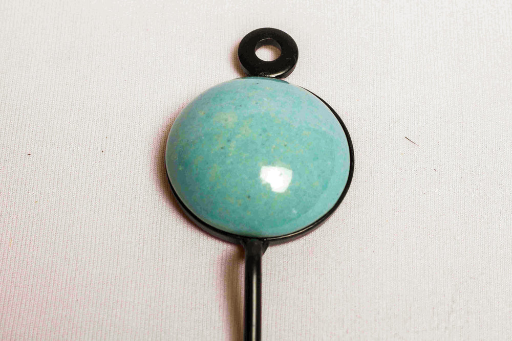 Single ceramic tile round wall hook in plain blue