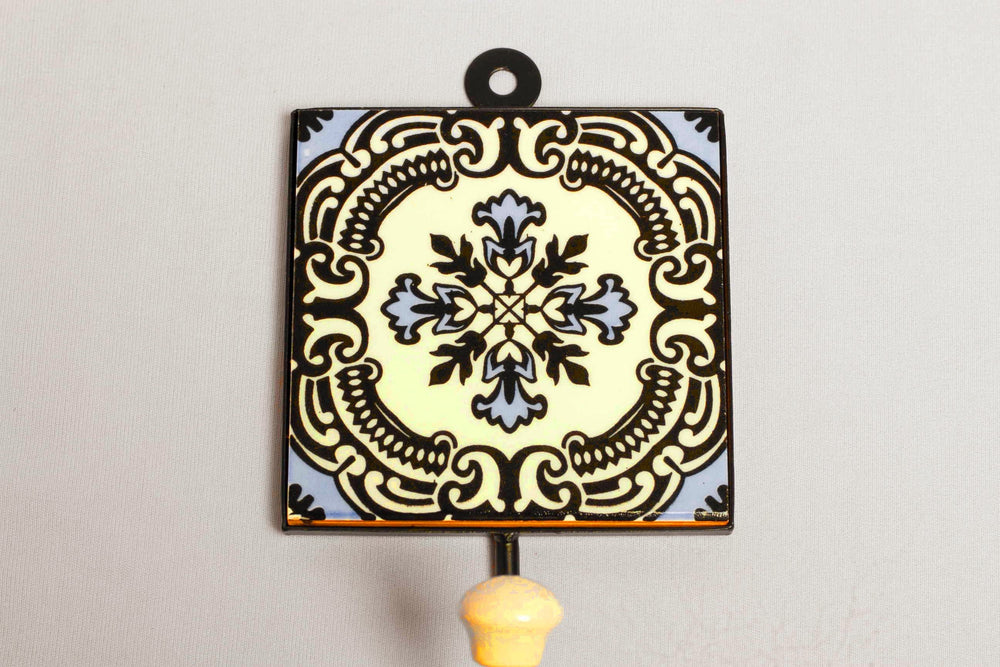Metal and single ceramic tile with a peg wall hook, white with blue floral motif