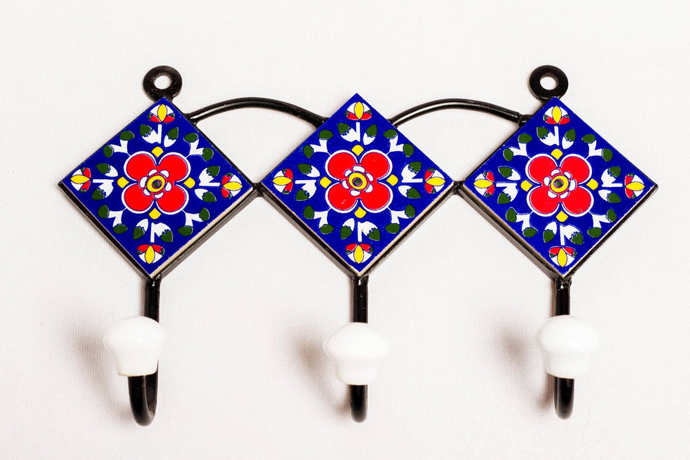 Metal and 3 ceramic tile with 3 peg wall hook, blue with red and yellow motif
