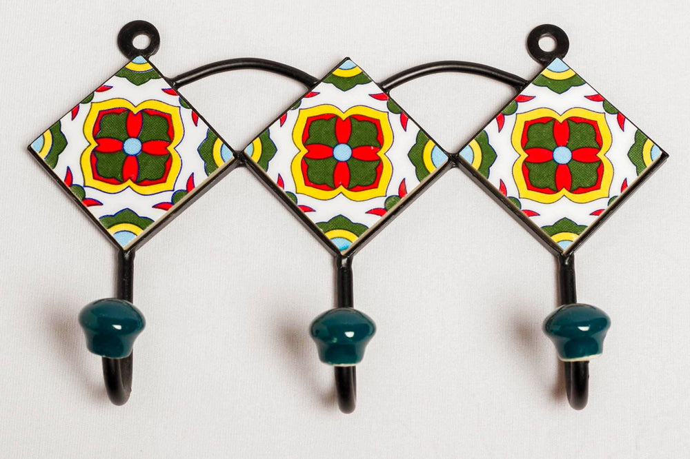 etal and 3 ceramic tile with 3 peg wall hook, white with red and yellow floral motif