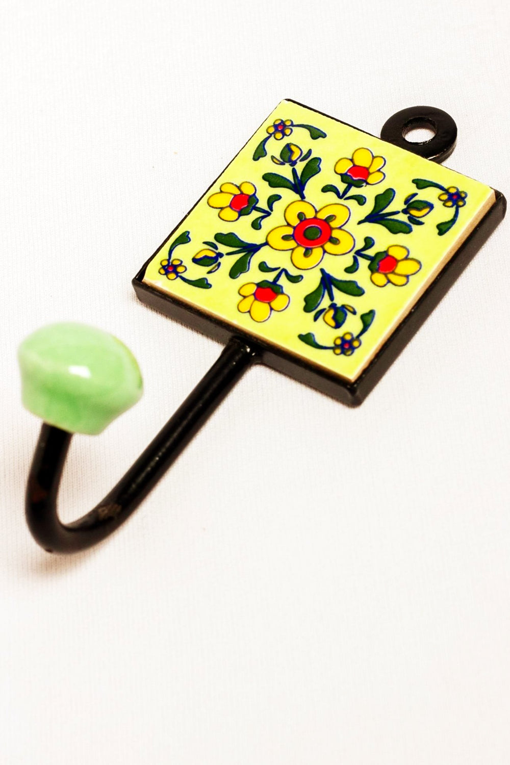 Metal and single ceramic tile wall hook, green with yellow and red floral motif