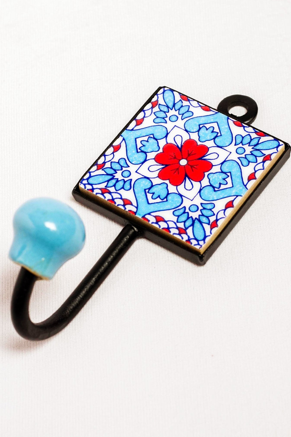 Metal and single ceramic tile wall hook, white with blue and red floral motif