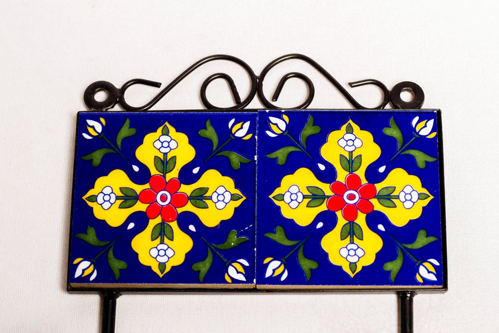 Metal and single ceramic tile wall hook, blue with yellow and red floral motif
