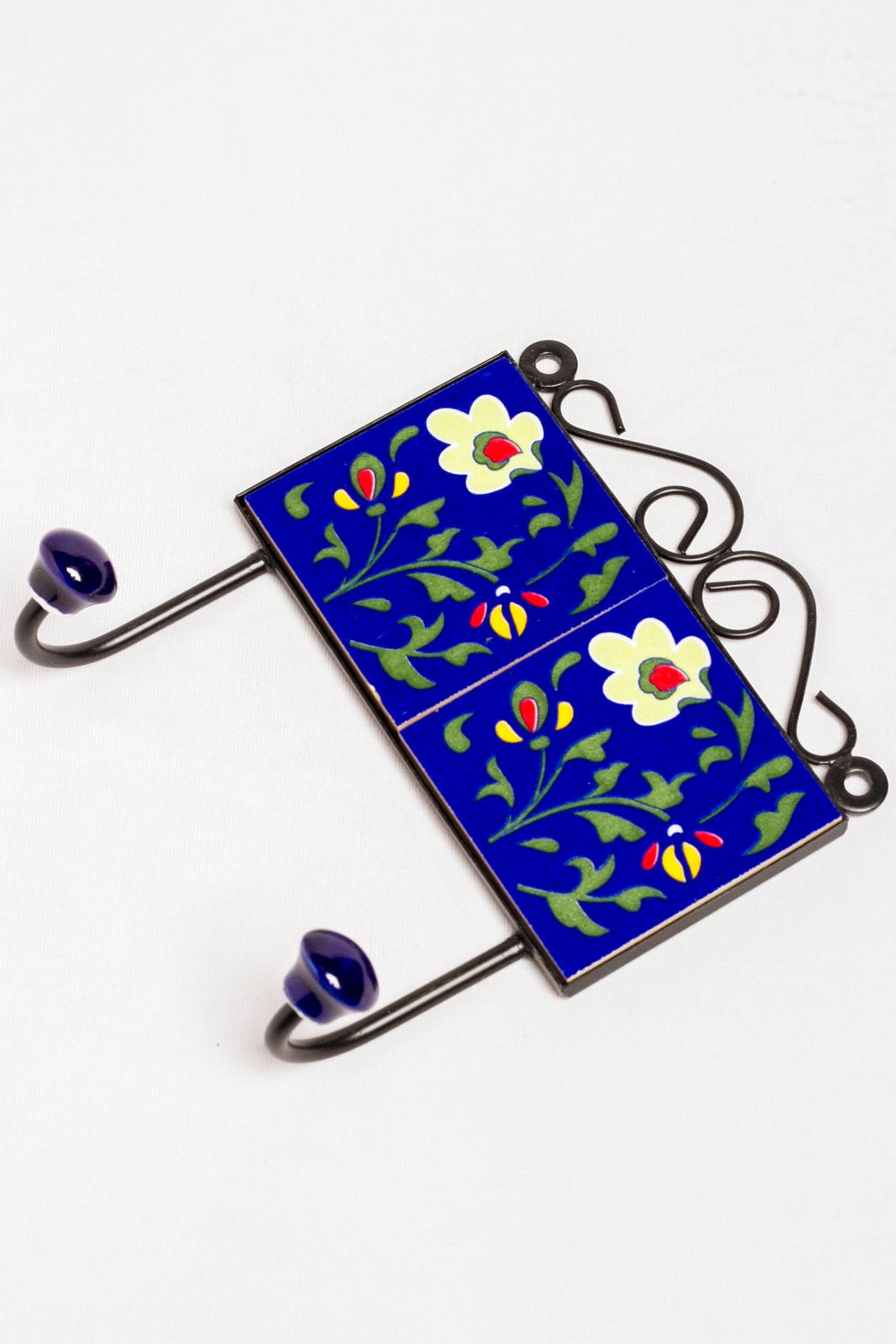 Metal and single ceramic tile wall hook, blue with green and red floral motif