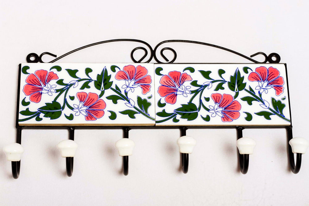 Metal and 2 ceramic tile with 6 peg wall hook, white with red and green motif.