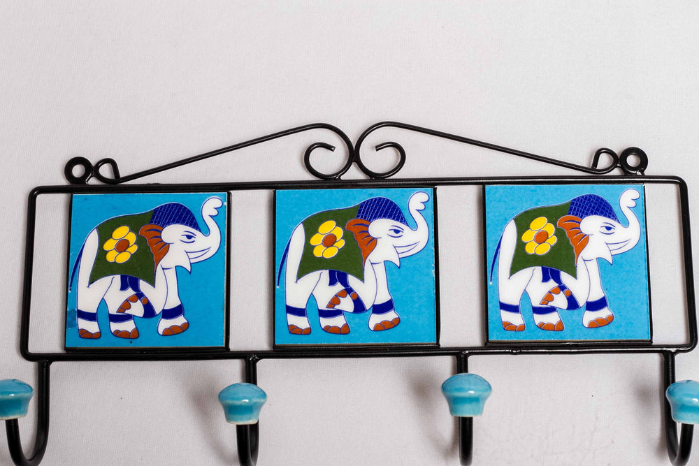 Metal and three ceramic tile with a 4 peg wall hook, blue with elephant motif