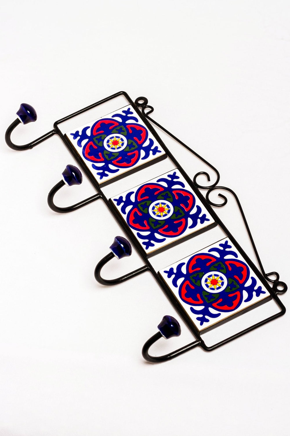 Metal and three ceramic tile with a 4 peg wall hook, white with blue and red floral motif