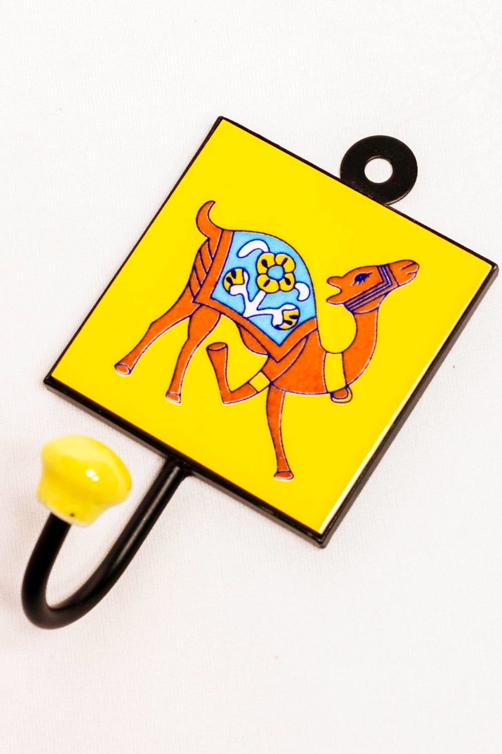 Metal and ceramic wall hook yellow, with camel facing right motif