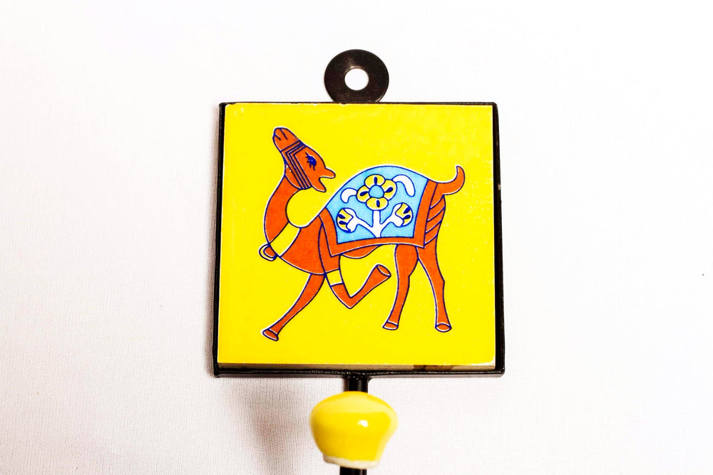 Metal and ceramic wall hook, yellow with camel facing left motif