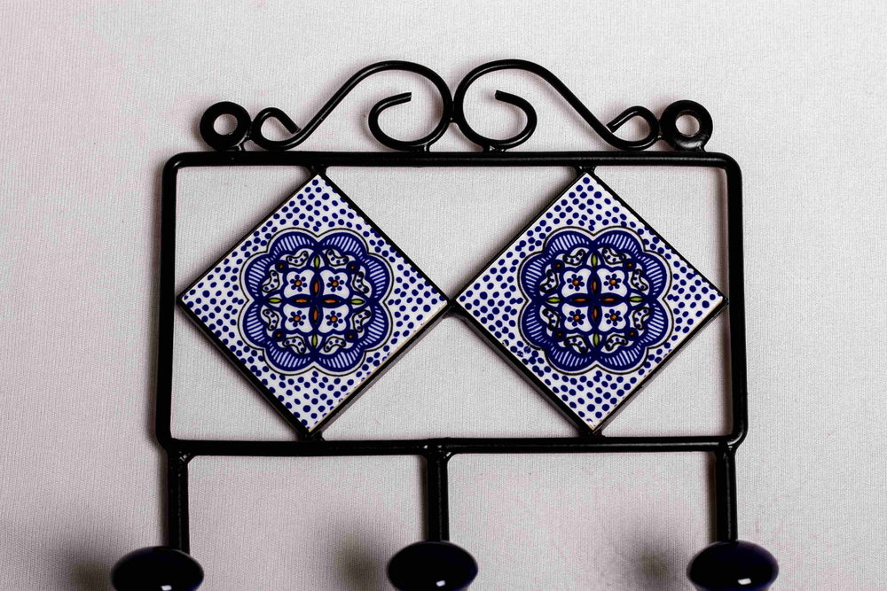 Metal and two diamond ceramic tile with a 3 peg wall hook, white with blue and red floral motif