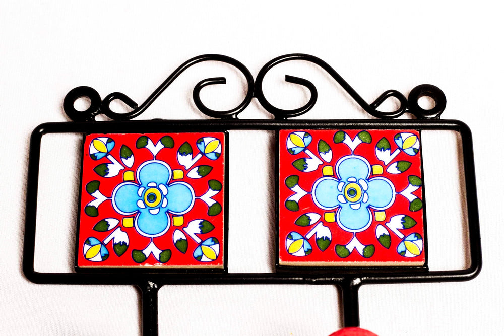 Metal and two square ceramic tile with a 3 peg wall hook, red with blue and white floral motif