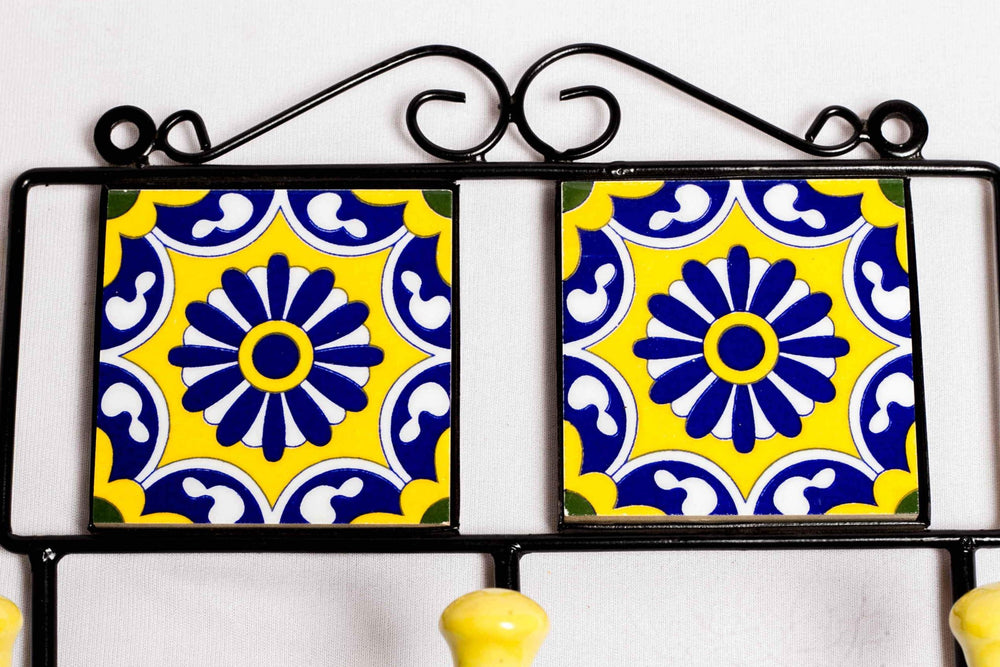 Metal and two square ceramic tile with a 3 peg wall hook, yellow with blue and white floral motif