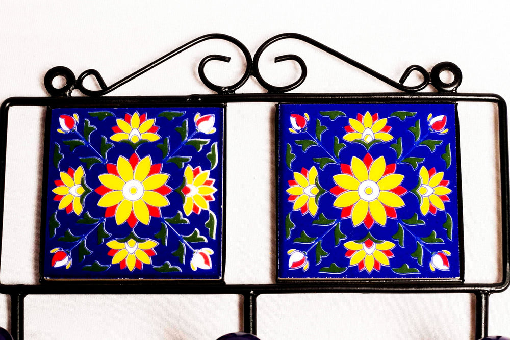 Metal and two square ceramic tile with a 3 peg wall hook, blue with yellow and red floral motif