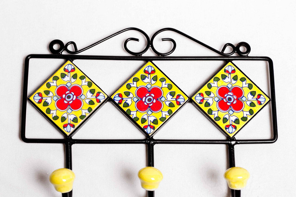 Metal and ceramic 3 tile 3 hook frame in yellow with red and blue floral motif
