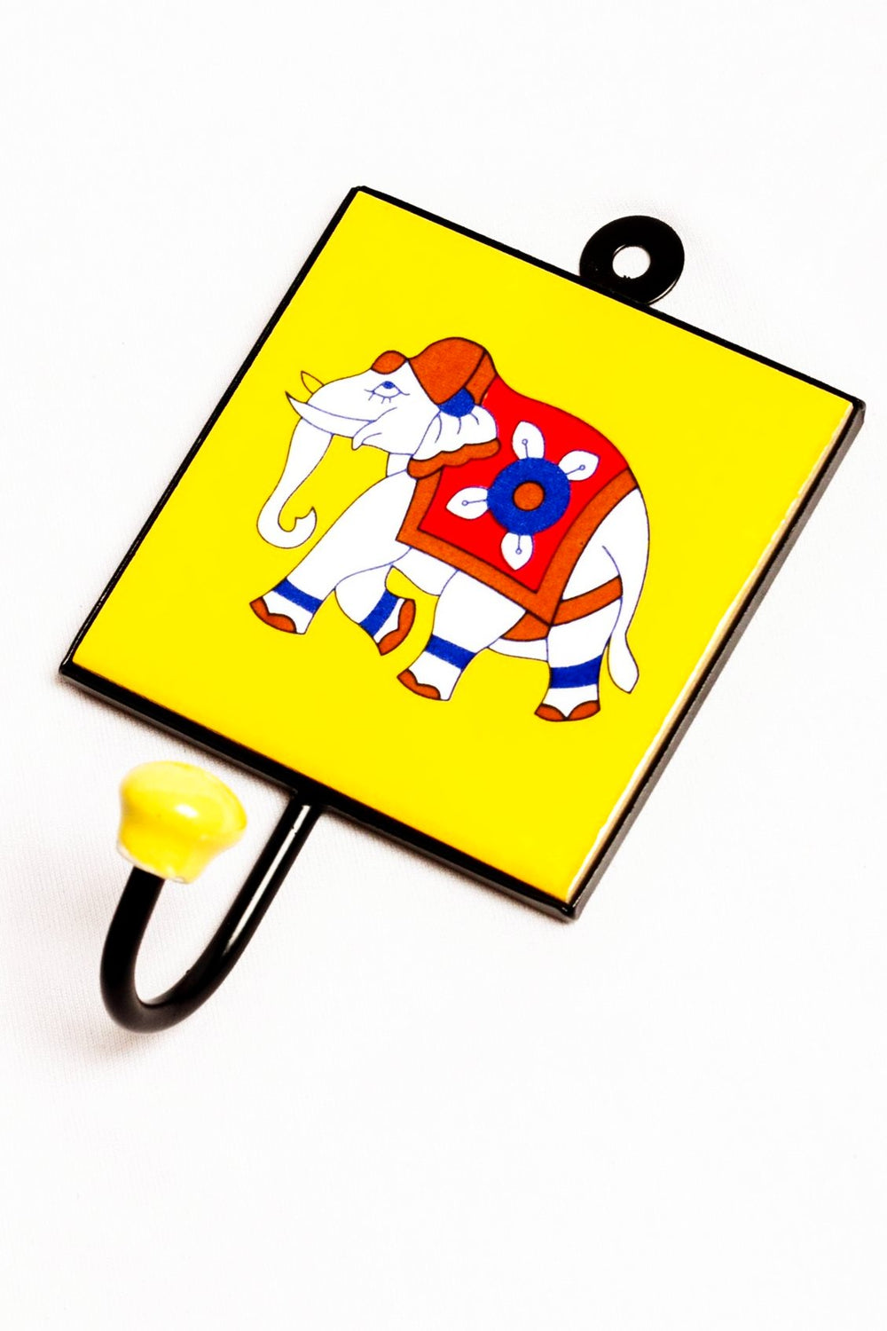 Metal and single ceramic tile with a peg wall hook, yellow with elephant motif