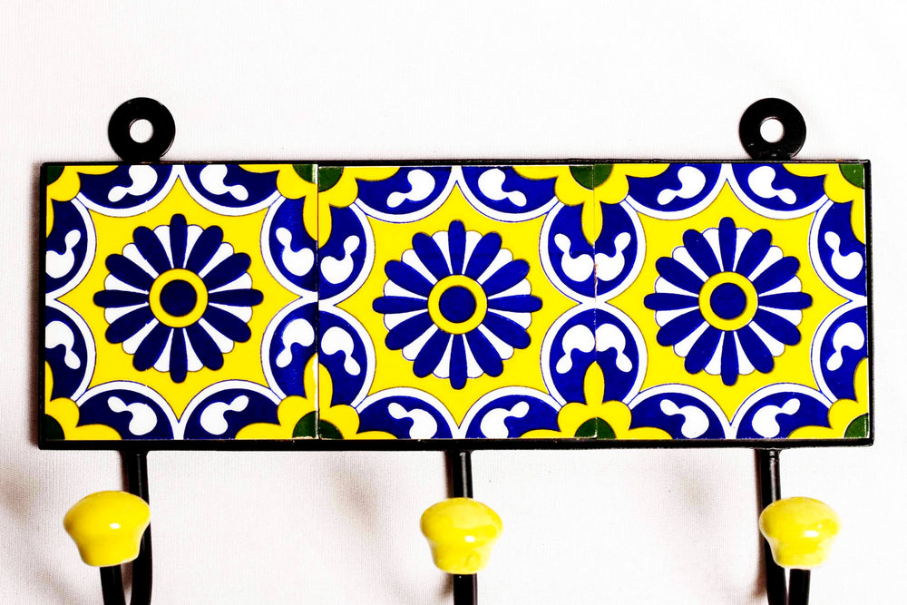 Metal and three ceramic tile with a 3 peg wall hook, yellow with blue and white floral motif