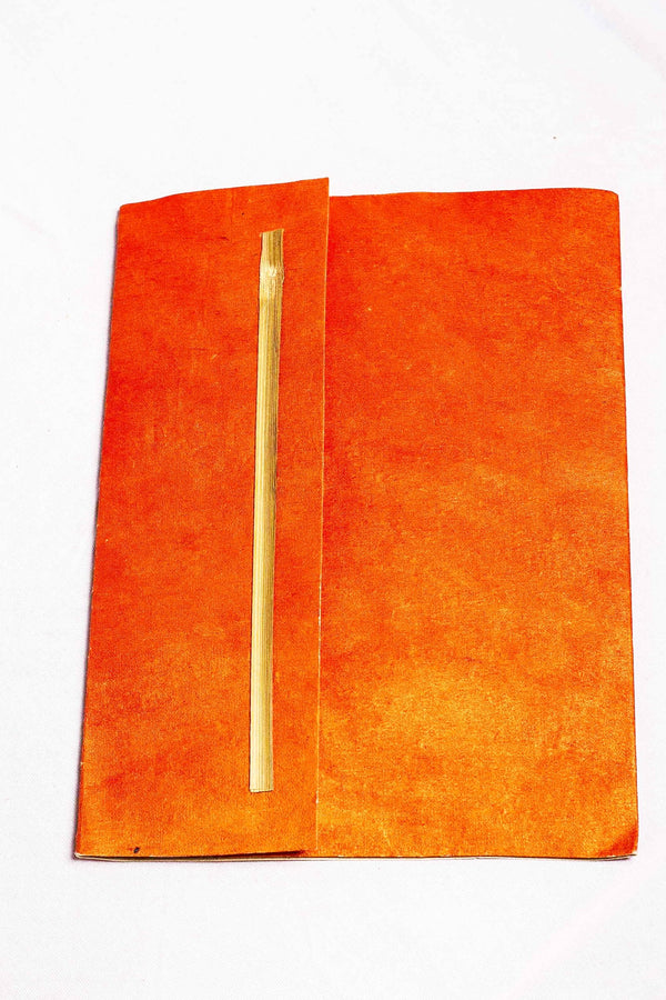 Orange organizer folder with stick motif containing writing sheet and envelope set