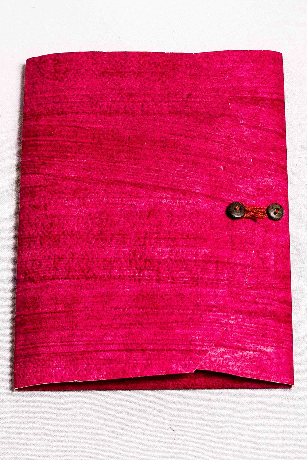 Fuschia button down organizer folder containing writing sheet and envelope set.