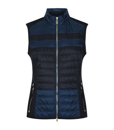 Kyra is a an astonishingly light weight, breathable, water-repellent two-tone golf vest for women. Navy Blue