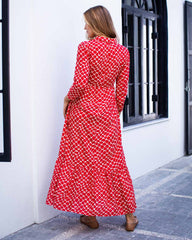 Woman wearing red and white netted ankle length print dress. With a collar and cuffed sleeves.