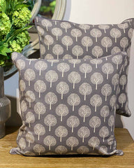 Two large cushions both printed with lots of white mulberry trees on grey.