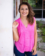 Woman in a relaxed fit with a V neckline sleeveless top, printed in a hot pink pebble print.
