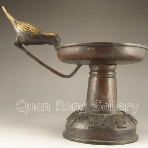 Chinese bronze Candlestick Holder with a Bird Handle - Roadshow Collectibles