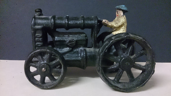 Toy Farm Tractor, Cast Iron, Male Driver - Roadshow Collectibles