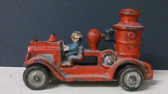 Toy Fire Truck, Cast Iron, Male Driver - Roadshow Collectibles