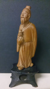 Shanghai China Hand Carved Bamboo Figure Of a Asian Male Holding a Small Sack - Roadshow Collectibles