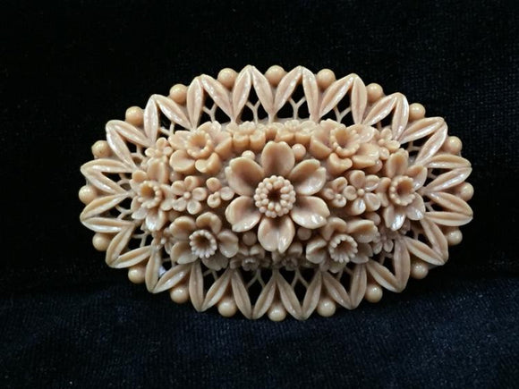 1930s-1940s Carved Celluloid Chrysanthemum Basket Brooch - Roadshow Collectibles